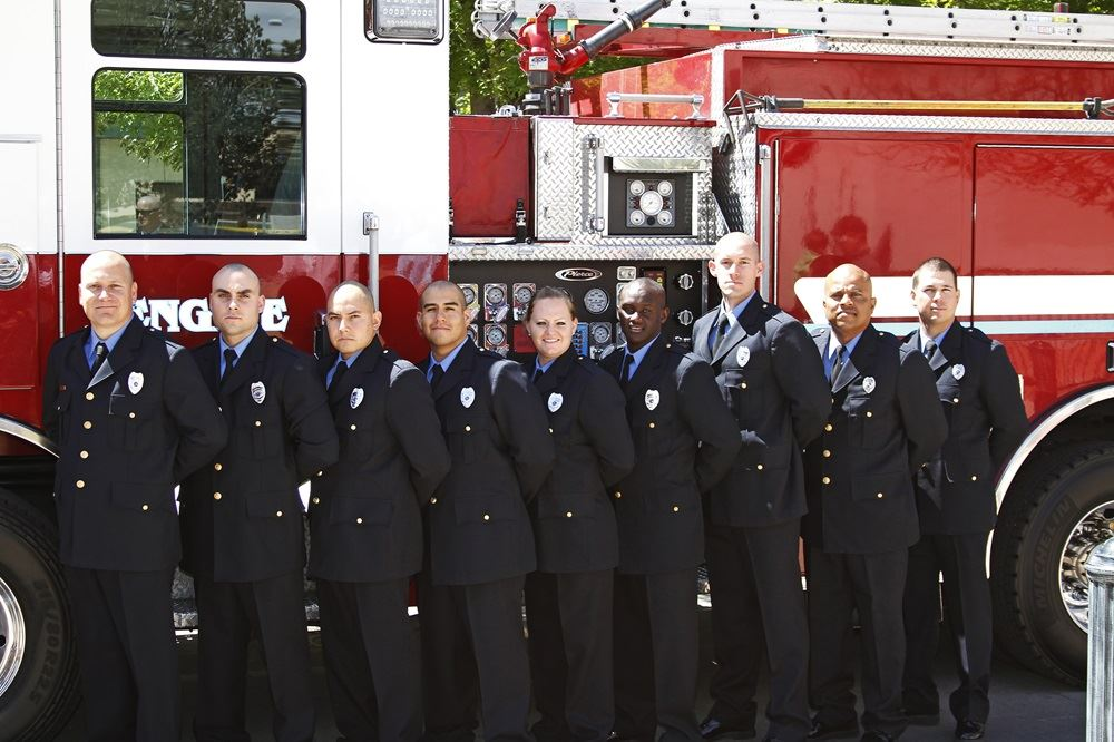 Group Photo of Firefighters in Their Dress Uniform Standing in Front of a Fire Truck