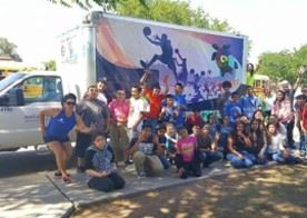 A group of people poses in front of the Teen Mobile