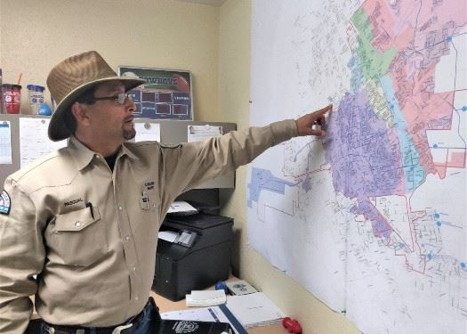 a career with LCU - Pascual Rod pointing at location on the map