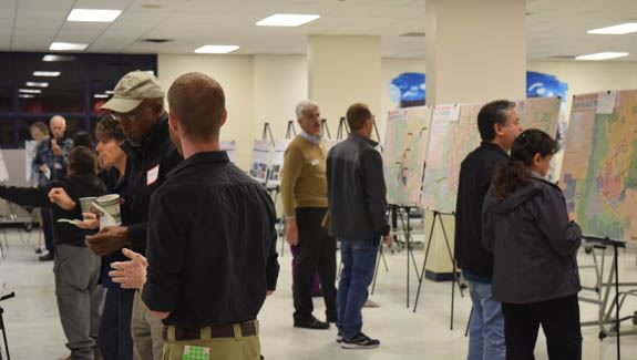 People Looking at displays to illustrate engagement of the Elevate Las Cruces Comprehensive plan